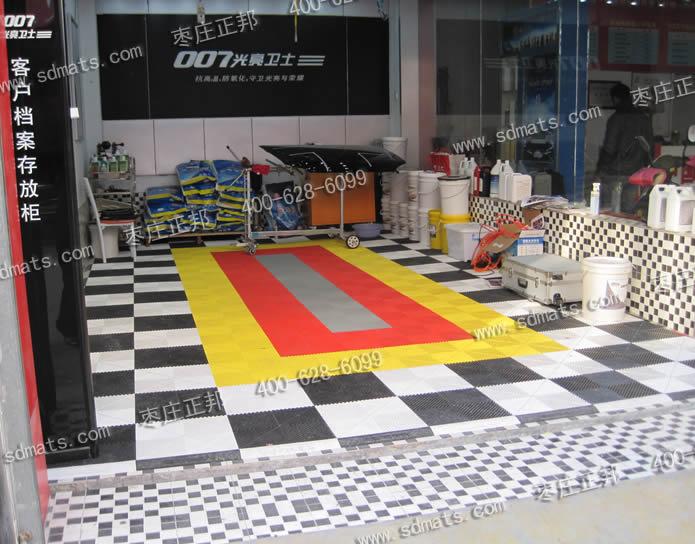 007光亮卫视汽车美容店贴膜车间装修效果